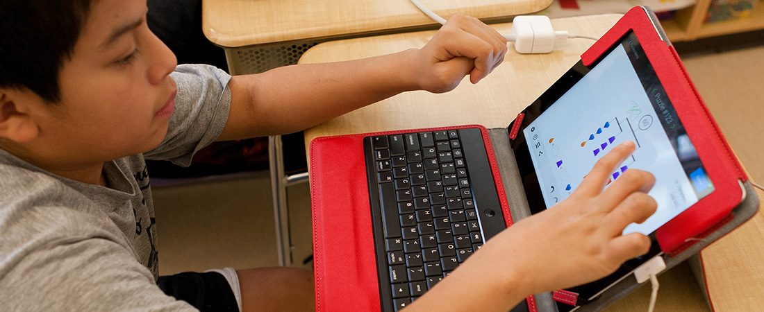 Students using EDC's SolveMe Mobiles app