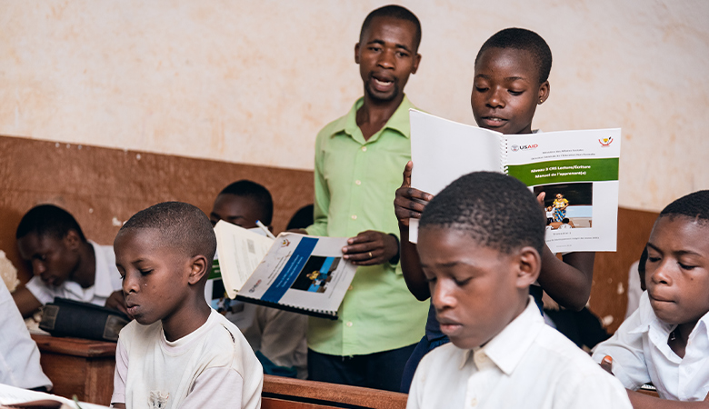 A classroom photo representing USAID/DRC Integrated Youth Development Activity (IYDA)