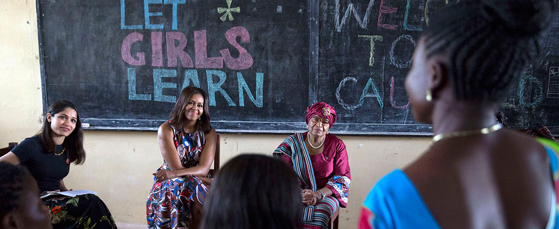 First Lady Michelle Obama hears from Rebecca Flomo, a learner in the USAID Advancing Youth Program in Liberia. Mrs. Obama's visit was part of the Let Girls Learn initiative.