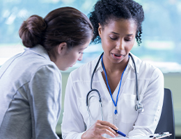 A photo of healthcare worker with patient
