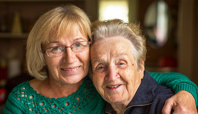 A photo of a woman with her elderly mother.