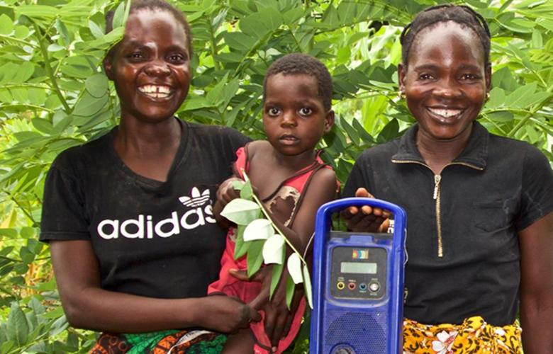 A photo of parents and child with a radio