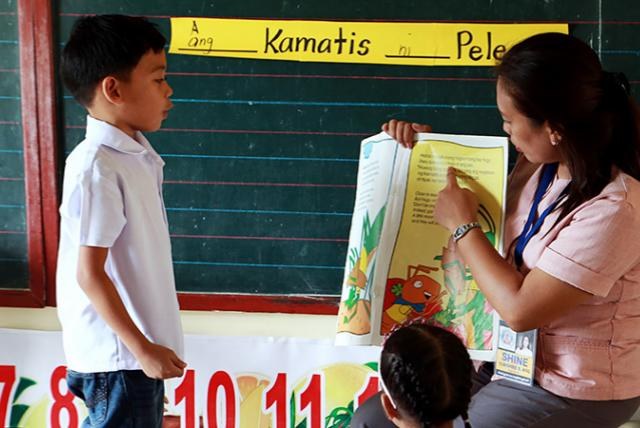 A photo of teacher and student from Basa Pilipinas program