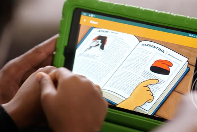A child using a tablet representing Conducting Research That Is Both Rigorous and Culturally Responsive