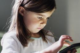 A photo of a child using a tablet.