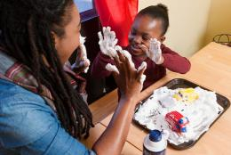 A photo of a parent and child representing 5 Tips for Keeping Your Kids Engaged During Coronavirus