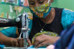 A photo of youth in DRC sewing face masks