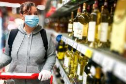A photo of a person shopping for alcohol representing Balancing Competing Priorities: Preventing Substance Misuse during COVID-19