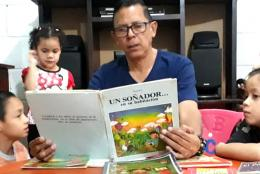 A photo of a family reading in Honduras representing With Schools Closed, Honduran Students Learn at Home