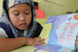 A photo of a student reading in the Philippines