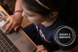Photo of a child using a computer