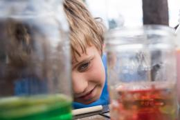 A photo of a child doing science
