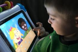 A photo of a child using a tablet